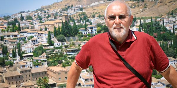 MAN AT THE ALHAMBRA IN CORDOBA, SPAIN